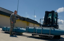 Staff Sgt. Brenton Gibbs, 5th Munitions Squadron munitions inspector, guides Senior Airman Charles Hamilton, 5th Munitions Squadron stockpile management support technician, with an inert BDU-56 bomb during Global Strike Challenge at Minot Air Force Base, N.D., June 19, 2017. The forklift rodeo was part of many events during Global Strike Challenge. (U.S. Air Force Photo by Staff Sgt. Chad Trujillo)
