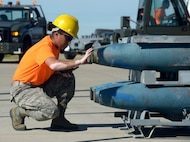 Airman 1st Class Benicia Burnette, 5th Munitions Squadron conventional maintenance specialist, assembles a BDU-56 bomb at Minot Air Force Base, N.D., June 20, 2017. The Airmen trained for Global Strike Challenge 2017. (U.S. Air Force Photo by Staff Sgt. Chad Trujillo)