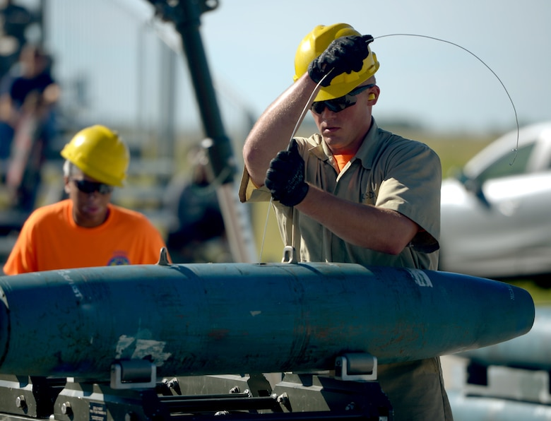 Airman 1st Class Colin Loehr, 5th Munitions Squadron munitions specialist, assembles a BDU-56 bomb at Minot Air Force Base, N.D., June 20, 2017. The Airmen trained for Global Strike Challenge 2017. (U.S. Air Force Photo by Staff Sgt. Chad Trujillo)