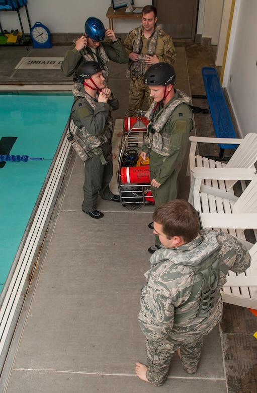 Members of the 54th Helicopter Squadron prepare for underwater egress survival training at Minot Air Force Base, N.D., June 22, 2017. The training included demonstrations on how to escape a simulated helicopter crash and properly use common rescue devices. (U.S. Air Force photo by Airman 1st Class Jonathan McElderry)