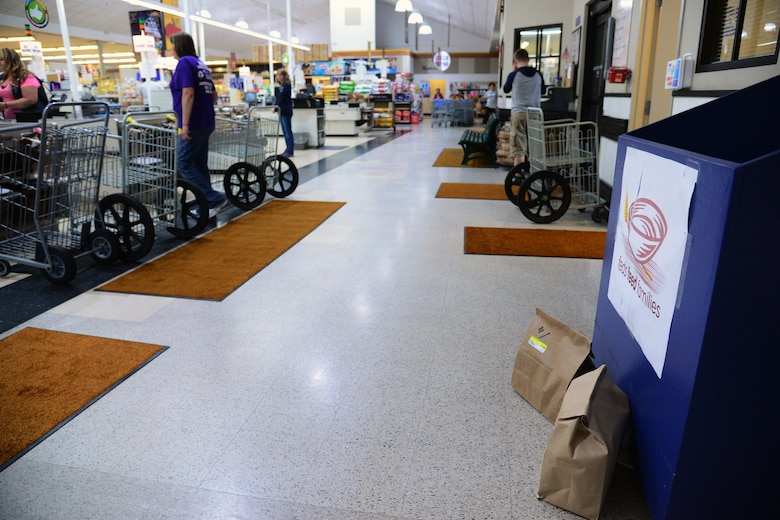 The Feds Feed Families donation collection box is located near the checkout lanes at the Malmstrom Commissary June 29, 2017, at Malmstrom Air Force Base, Mont. In 2016, the commissary donated 1,863 pounds of items and the 2017 goal is 2,000 pounds. (U.S. Air Force photo/Senior Airman Magen M. Reeves)