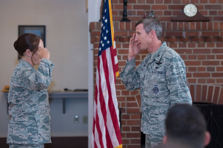 Col. Thomas Kunkel, 23d Wing commander, renders a salute to Lt. Col. Cynthia Kearley, 23d Wing Staff Judge Advocate and Leadership Moody, Emerge Moody cadre member, for an exceptional job during Moody's first 2017 Emerge Moody, Leadership Moody  installment at a graduation ceremony, June 23, 2017, at Moody Air Force Base, Ga. Kearley was coined for her efforts in spearheading the programs which were designed to enhance  participant's Air Force networks and their continued growth as Air Force leaders throughout their career. (U.S. Air Force photo by Senior Airman Greg Nash)