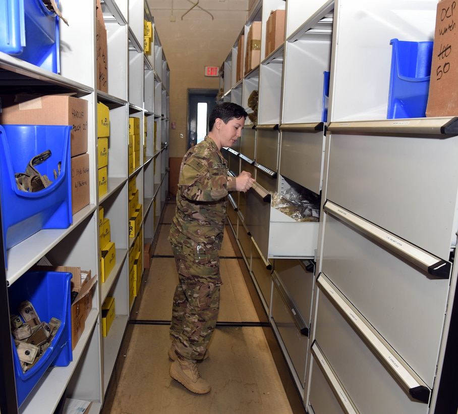 Senior Airman Christina Costa, 90th Security Support Squadron supply custodian, inspects supply inventory at F.E. Warren Air Force Base, Wyo., May 12, 2017. The 90th SSPTS provides gear and equipment to more than 1,200 defenders on base. (U.S. Air Force photo by Airman 1st Class Breanna Carter)