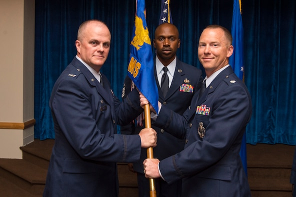 Col. Todd Sauls, 90th Operations Group commander, passes the guidon to Lt. Col. Joel Douglas, 321st Missile Squadron commander, during the 321st MS change of command ceremony at F.E. Warren Air Force Base, Wyo., June 29, 2017. The ceremony signified the transition of command from Lt. Col. Johnny Galbert. (U.S. Air Force photo by Staff Sgt. Christopher Ruano)
