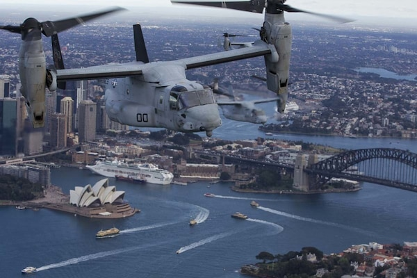 A set of MV-22B Osprey tiltrotor aircraft fly in formation above Sydney Harbor.  Below are the world-famous Sydney Opera House and Sydney Harbor Bridge. The MV-22Bs belong to Marine Medium Tiltrotor Squadron 265 (Reinforced), June 29, 2017. VMM-265 (Rein.) is part of the Aviation Combat Element of the 31st Marine Expeditionary Unit. The 31st MEU and the Bonhomme Richard Expeditionary Strike Group arrived in Sydney after transiting south across the vast Pacific Ocean, from Okinawa, Japan, to southeastern Australia in just over three weeks. Sydney is a favorite port stop for both Marines and Sailors crossing the Pacific. The 31st MEU partners with the Navy's Amphibious Squadron 11 to form the amphibious component of the Bonhomme Richard Expeditionary Strike Group. The 31st MEU and PHIBRON 11 combine to provide a cohesive blue-green team capable of accomplishing a variety of missions across the Indo-Asia-Pacific region.