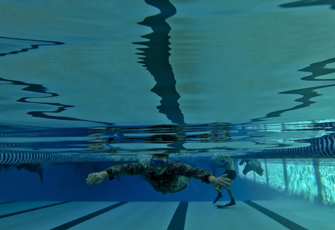 A U.S. Air Force airman from the New Jersey Air National Guard's 108th Wing swims a timed event during a German Armed Forces Badge for Military Proficiency test at Joint Base McGuire-Dix-Lakehurst, N.J., June 13, 2017. The test included an 1x10-meter sprint, flex arm hang, 1,000 meter run, 100 meter swim in Military Uniform, marksmanship, and a timed foot march. (U.S. Air National Guard photo by Master Sgt. Matt Hecht/Released)