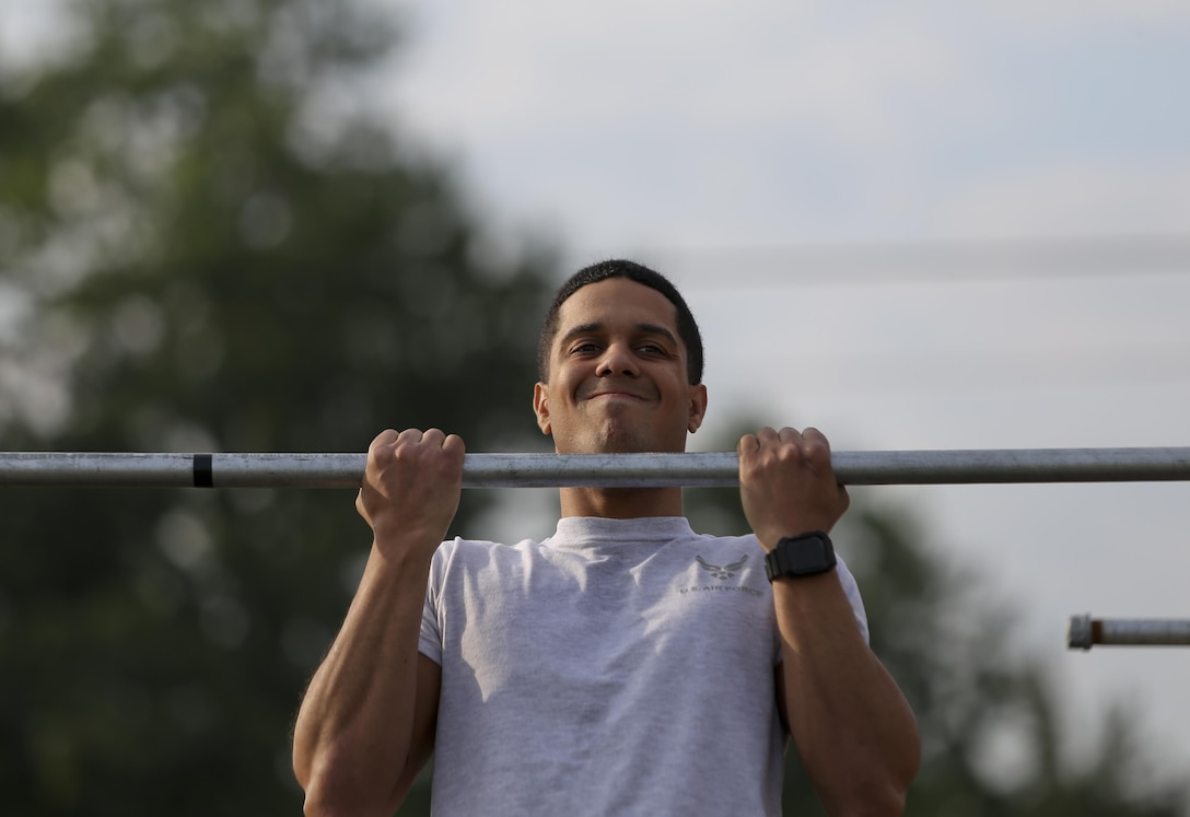 A U.S. Air Force airman from the New Jersey Air National Guard's 108th Wing does the flex arm hang during a German Armed Forces Badge for Military Proficiency test at Joint Base McGuire-Dix-Lakehurst, N.J., June 13, 2017. The test included an 1x10-meter sprint, flex arm hang, 1,000 meter run, 100 meter swim in Military Uniform, marksmanship, and a timed foot march. (U.S. Air National Guard photo by Master Sgt. Matt Hecht/Released)