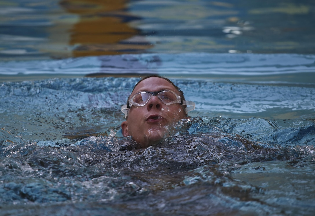 A U.S. Air Force airman from the New Jersey Air National Guard's 108th Security Forces Squadron swims the 100 meter challenge during a German Armed Forces Badge for Military Proficiency test at Joint Base McGuire-Dix-Lakehurst, N.J., June 13, 2017. The test included an 1x10-meter sprint, flex arm hang, 1,000 meter run, 100 meter swim in Military Uniform, marksmanship, and a timed foot march. (U.S. Air National Guard photo by Master Sgt. Matt Hecht/Released)