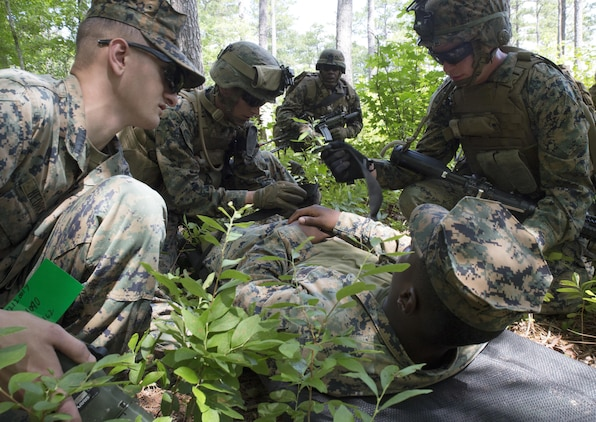 Marines with Fox Company, 2nd Battalion, 2nd Marine Regiment practice first aid on a simulated wounded pilot and strap him to a stretcher during a Tactical Recovery of Aircraft and Personnel exercise at Camp Lejeune, N.C., June 29, 2017. The Marines conducted the TRAP as part of their Certification Exercise in preparation for an upcoming deployment as the Special Purpose Marine Air-Ground Task Force-Crisis Response-Africa. Due to the time-sensitive nature of a TRAP mission, the Marines constantly train to maintain and improve their proficiency in recovering personnel and destroying or retrieving classified equipment. (U.S. Marine Corps photo by Lance Cpl. Raul Torres)