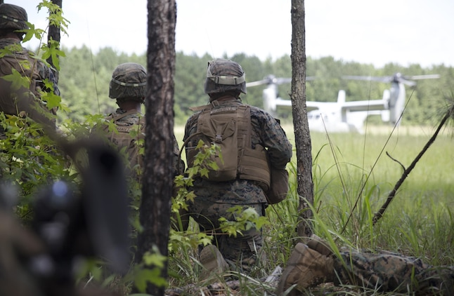 Marines with Fox Company, 2nd Battalion, 2nd Marine Regiment get ready to evacuate a recovered pilot to an MV-22B Osprey during a Tactical Recovery of Aircraft and Personnel exercise at Camp Lejeune, N.C., June 29, 2017. The Marines conducted the TRAP as part of their Certification Exercise in preparation for an upcoming deployment as the Special Purpose Marine Air-Ground Task Force-Crisis Response-Africa. Due to the time-sensitive nature of a TRAP mission, the Marines constantly train to maintain and improve their proficiency in recovering personnel and destroying or retrieving classified equipment. (U.S. Marine Corps photo by Lance Cpl. Raul Torres)