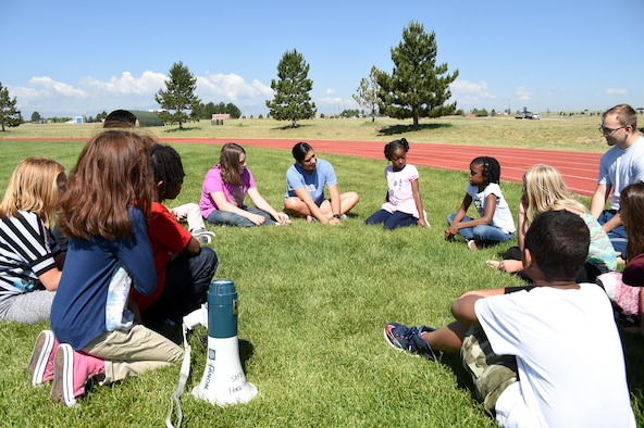 Children attending the Summer Enrichment Program socialize each other at Schriever Air Force Base, Colorado, Monday, June 26, 2017. This year marks the second time the base hosted this program.(U.S. Air Force photo/Senior Airman Arielle Vasquez)