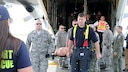 Twelve airmen from the 104th Medical Group and seven airmen from the 102nd Medical Group participated in a mass casualty training at the Earhart Terminal at Logan Airport in Boston Massachusetts.  Also present were members of the 139th Aeromedical Evacuation Squadron, part of the 109th Airlift Wing at Stratton Air National Guard Base, Scotia NY, who came in on the C-130 where most of the exercise took place.  (U.S. Air National Guard Photos by Tech. Sgt. Lindsey Sarah Watson-Kirwin)