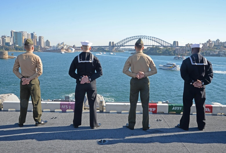 Sailors and Marines man the rails as the amphibious assault ship USS Bonhomme Richard (LHD 6) pulls into the Sydney Harbor as part of a port visit, June 29,2017. Bonhomme Richard is in Sydney to advance U.S. – Australian relations ahead of the bilateral training exercise Talisman Saber. During the visit, Bonhomme Richard will host a reception, ships tours and experience the culture of the historic city.