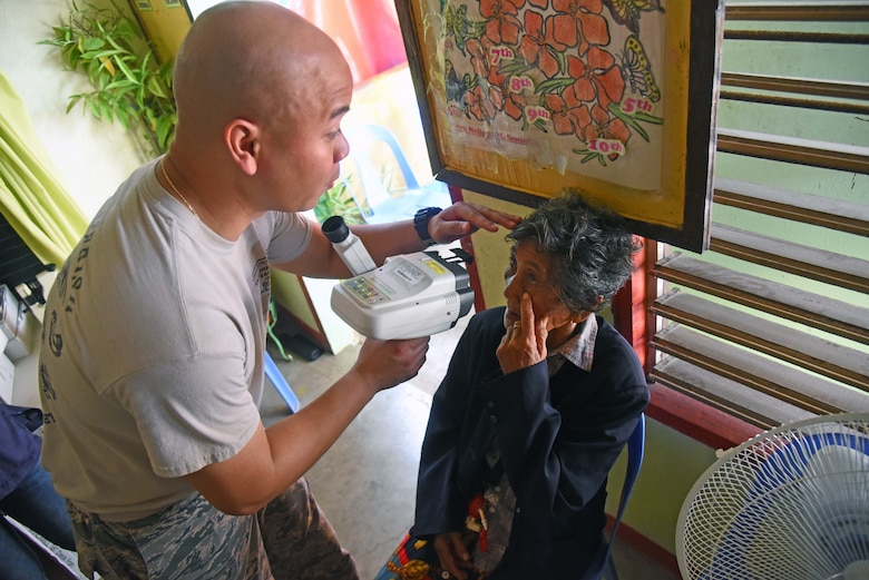 U.S. Air Force Staff Sgt. Kim Piad, optometry technician with the 673rd Medical Group, Joint Base Elmendorf-Richardson, Alaska, conducts an eye sight test on a woman from Bogo City during Pacific Angel 2017 in Northern Cebu Province, Philippines, June 26, 2017. PACANGEL participants from six different nations work together with local nongovernmental organizations to administer medical care, including general health, optometry, dental, physical therapy and pediatrics, to the people of Northern Cebu Province. (U.S. Air Force photo by Tech. Sgt. Jeff Andrejcik)
