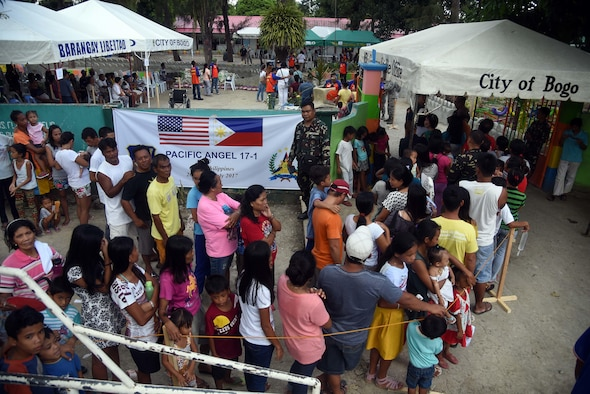 Local community member's form a line outside of a Pacific Angel 2017 health services site in Northern Cebu Province, Bogo City, Philippines, June 26, 2017. PACANGEL is a multilateral humanitarian assistance civil military engagement, which improves military-to-military partnerships in the Pacific while also providing medical health outreach, civic engineering projects and subject matter exchanges among partner forces.  (U.S. Air Force photo by Tech. Sgt. Jeff Andrejcik)
