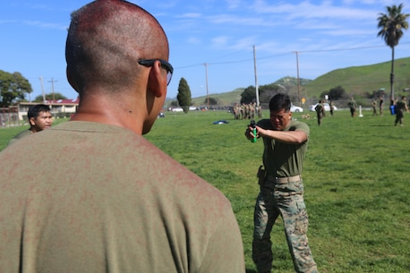 A U.S. Marine assigned to the 1st Battalion, 11th Marines, Charlie Battery, the non-lethal weapons company for the 15th Marine Expeditionary Unit (MEU), demonstrated he can still maintain cognizance and bearing with a hostile individual after taking a shot of OC spray to the face during OC certification on Camp Pendleton, Feb. 14, 2017. The 15th MEU used this training to sharpen their skills in a variety of non-lethal weapons tactics they would use to stabilize hostile situations. These non-lethal capabilities add to the flexibility of the MEU to shape actions across the range of military operations to resolve conflict anyway in the world. (U.S. Marine Corps photo by Lance Cpl. Jacob Pruitt)