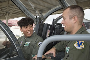 Angel Vasquez, 12th Flying Training Wing pilot for a day, checks out the cockpit of a T-38C Talon June 29, 2017, at Joint Base San Antonio-Randolph. The Pilot for a Day program participants battle a variety of illnesses and diseases, to include terminal illnesses. For many children with severe, but not terminal illnesses, the program is a significant milestone in their recovery. (U.S. Air Force photo by Sean Worrel)