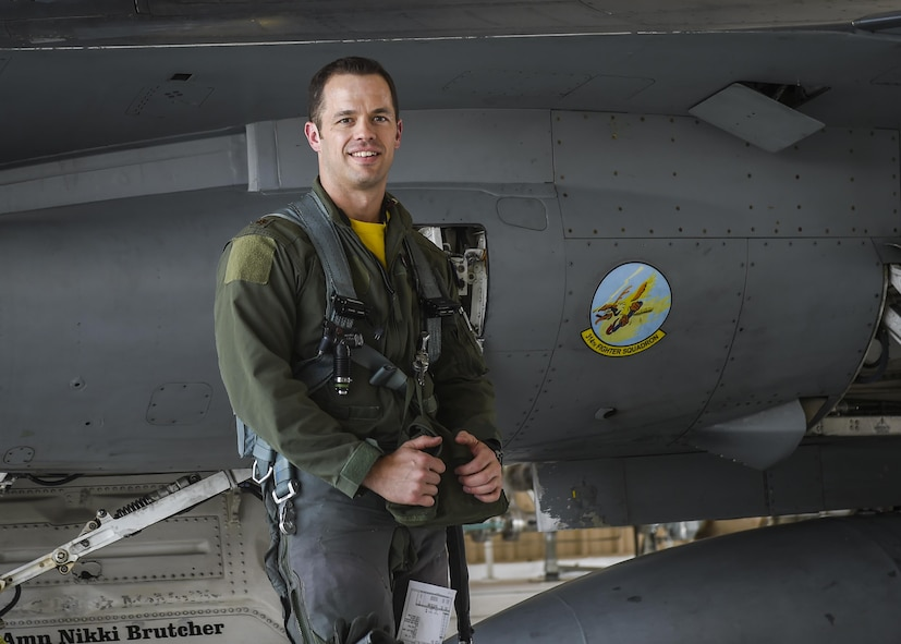 Maj. John R. Widmer, 314th Fighter Squadron flight commander and an F-16 instructor pilot, poses for a photo prior to flying in an F-16 Fighting Falcon at Holloman Air Force Base, N.M. June 23, 2017. Widmer was recently recognized as the Air Force's Fighter Instructor Pilot of the Year for his exemplary performance in and out of the jet. (U.S. Air Force photo by Airman 1st Class Alexis Docherty)