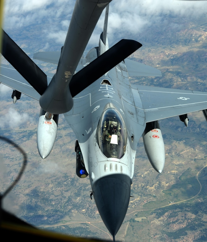 An F-16 Fighting Falcon, assigned to the 175th Fighter Squadron, Joe Foss Field, Air National Guard Station, Sioux Falls, S.D., is refueled by a KC-135 Stratotanker, assigned to the 18th Air Refueling Squadron, McConnell Air Force Base, Kan., during exercise Combat Raider near Ellsworth AFB, S.D., June 28, 2017. Over 20 aircraft participated in the joint exercise from eight military units throughout the United States. (U.S. Air force photo by Airman 1st Class Thomas Karol)
