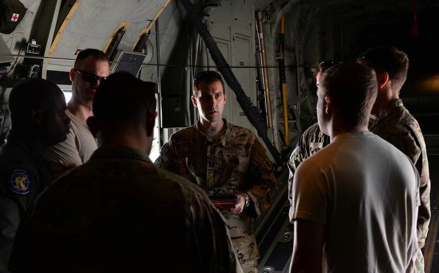 Capt. Carl Price, a C-130 Super Hercules pilot assigned to the 71st Rescue Squadron, Moody Air Force Base, Ga., briefs his crew before take-off at Ellsworth AFB, S.D., June 28, 2017. Price and his crew trained with other Air Force units in realistic air-to-air, air-to-ground and combat search and rescue missions. (U.S. Air Force photo by Airman Nicolas Z. Erwin)