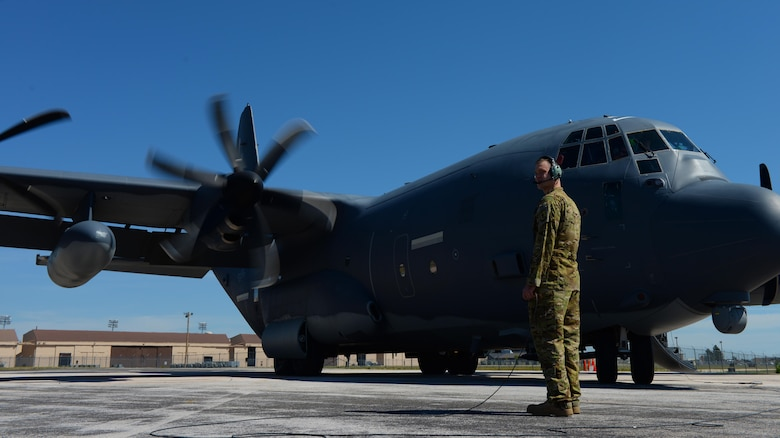 Staff Sgt. Philip Palmer, a C-130 Super Hercules loadmaster assigned to the 71st Rescue Squadron, Moody Air Force Base, Ga., watches a C-130 prime for flight during exercise Combat Raider at Ellsworth AFB, S.D., June 28, 2017. The C-130 is a versatile aircraft capable of performing combat search and rescue missions and refueling other aircraft. (U.S. Air Force photo by Airman Nicolas Z. Erwin)