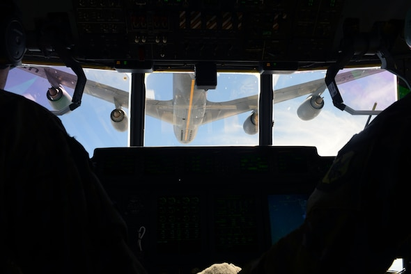 A C-130 Super Hercules prepares to be refueled by a KC-135 Stratotanker during exercise Combat Raider near Ellsworth Air Force Base, S.D., June 28, 2017. The exercise consisted of 22 aircraft from eight military units providing over 100 service members with realistic training scenarios. (U.S. Air Force photo by Airman 1st Class Donald C. Knechtel)