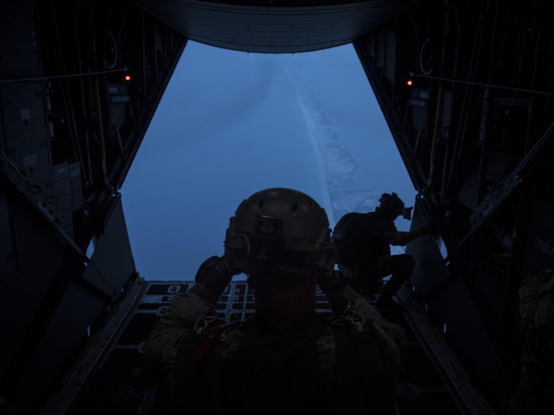 An instructor with the 1st Special Operations Support Squadron Operational Support Joint Office dons his helmet before jumping from a 15th Special Operations Squadron MC-130H Combat Talon II above northwest Florida, June 28, 2017. The 1st SOSS/OSJ facilitates special operations forces training to ensure global readiness. (U.S. Air Force photo by Airman 1st Class Joseph Pick)
