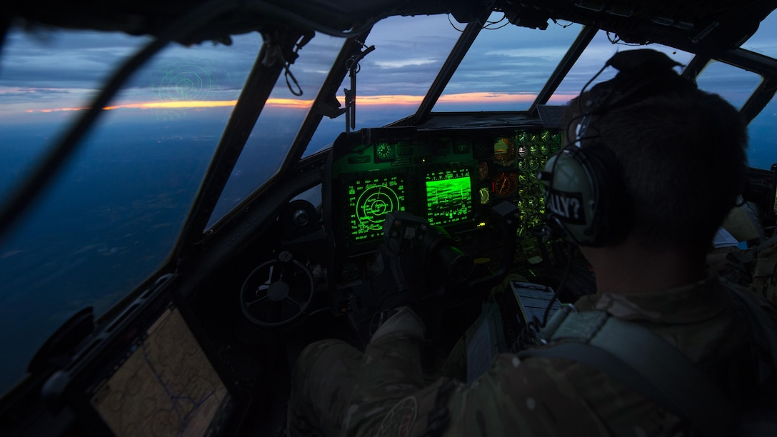 Lt. Col. Joshua Anderson, the director of staff with the 15th Special Operations Squadron, pilots a 15th SOS MC-130H Combat Talon II above northwest Florida, June 28, 2017. Aircrew with the 15th SOS conducted personnel airdrop, low-level terrain flying and touch-and-go landings to ensure their combat mission readiness. (U.S. Air Force photo by Airman 1st Class Joseph Pick)