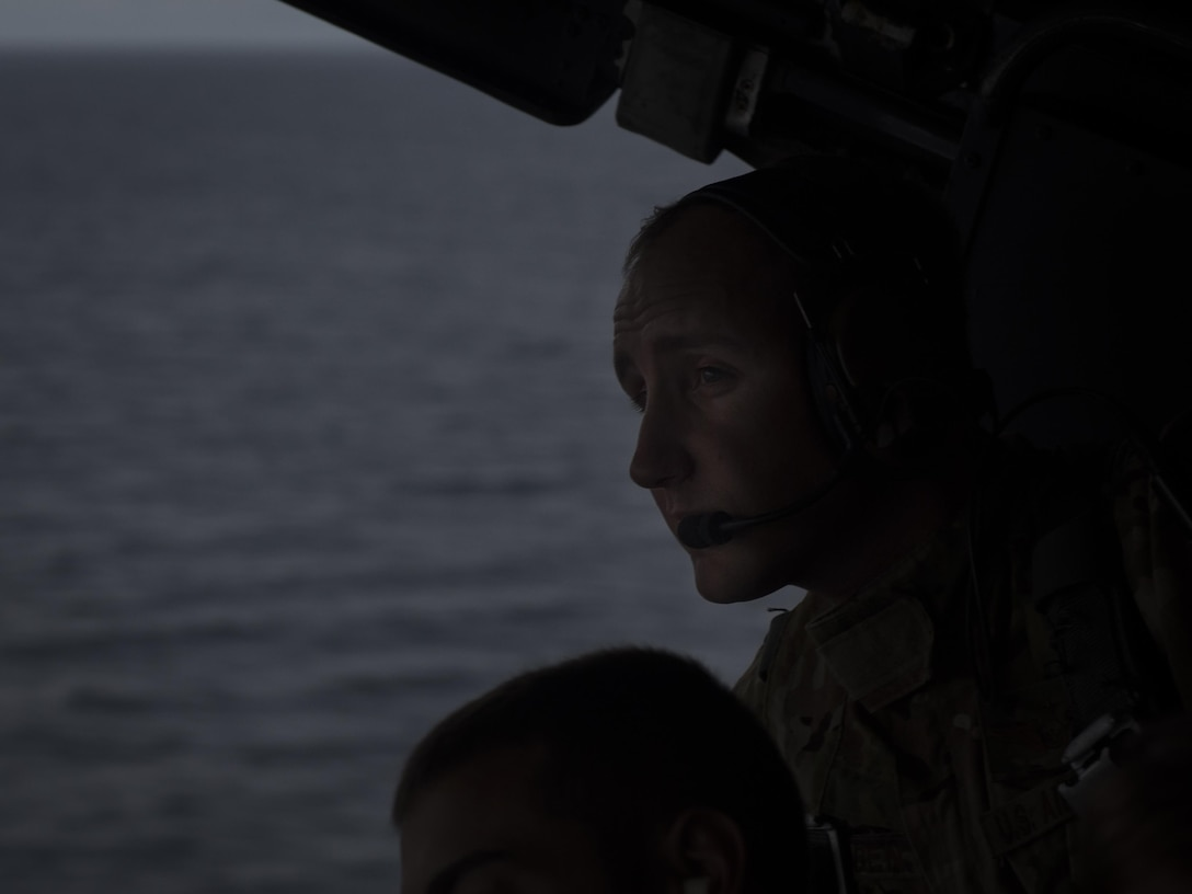 Tech. Sgt. Sheldon Rodden, a loadmaster with the 15th Special Operations Squadron, scans the horizon during a training mission on a 15th SOS MC-130H Combat Talon II above northwest Florida, June 28, 2017. Aircrew with the 15th SOS conducted personnel airdrops, low-level terrain flying and touch-and-go landings to ensure their combat mission readiness. (U.S. Air Force photo by Airman 1st Class Joseph Pick)