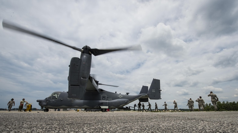 Junior ROTC cadets board an 8th Special Operations Squadron CV-22 Osprey tiltrotor aircraft at Hurlburt Field, Fla., June 27, 2017. More than 55 JROTC cadets from nearby high schools flew in a CV-22 and a 15th SOS MC-130H Combat Talon II as part of a JROTC familiarization flight. (U.S. Air Force photo by Airman 1st Class Joseph Pick)