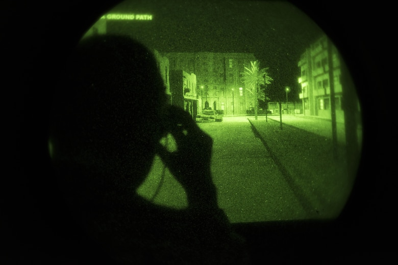 Airman 1st Class Jeff Eisberg, 22nd Training Group Survival Evasion Resistance and Evasion specialist, tries out a pair of night vision goggles during a simulation June 26, 2017, at Fairchild Air Force Base, Washington. the 92nd Aeromedical Squadron provides training to air crews and SERE specialists to help understand the advantages and limitations of night vision gear. (U.S. Air Force Photo / Airman 1st Class Ryan Lackey)