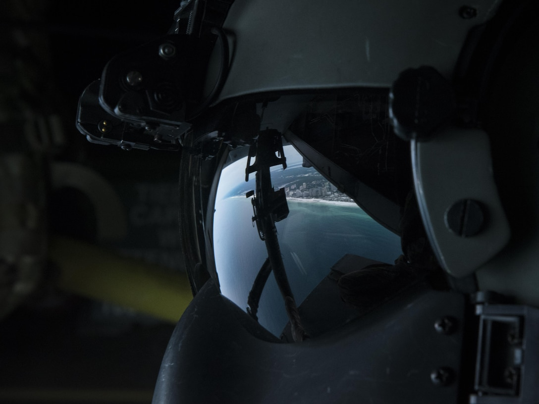 A special missions aviator with the 8th Special Operations Squadron scans the horizon from a CV-22 Osprey tiltrotor aircraft above northwest Florida, June 27, 2017. Special missions aviators perform pre-flight inspections of aircraft, monitor engines and check other critical flight systems during flights. (U.S. Air Force photo by Airman 1st Class Joseph Pick)