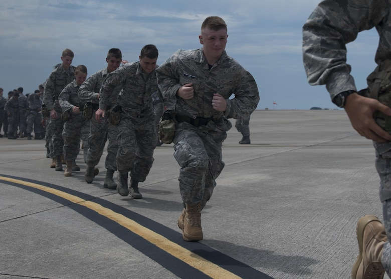 Junior ROTC cadets sprint toward a 15th Special Operations Squadron MC-130H Combat Talon II at Hurlburt Field, Fla., June 27, 2017. From June 26-30, more than 55 JROTC cadets from nearby high schools visited Hurlburt for Summer Leadership School - a course designed to teach cadets leadership, confidence and other traits as part of a JROTC familiarization flight. (U.S. Air Force photo by Airman 1st Class Joseph Pick)