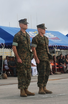 U.S. Marine Corps Maj. Gen. Russell A. Sanborn (left), outgoing 1st Marine Aircraft Wing commanding general, stands at attention with Brig. Gen. Thomas D. Weidley (right), the incoming commanding general, during a change of command ceremony at Marine Corps Air Station Futenma, Okinawa, Japan, June 29, 2017. Sanborn relinquished command to Weidley and will assume command at Marine Forces Europe and Africa. (U.S. Marine Corps photo by Lance Cpl. Isabella Ortega)