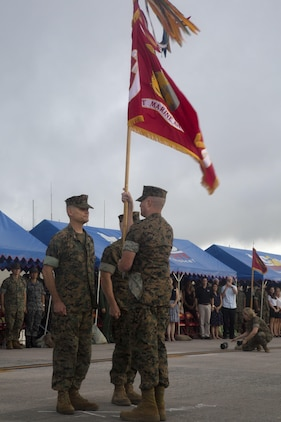 U.S. Marine Corps Sgt. Maj. Michael J. Pritchard passes the unit colors to Maj. Gen. Russell A. Sanborn, representing the passing of command during a change of command ceremony at Marine Corps Air Station Futenma, Okinawa, Japan, June 29, 2017. Sanborn, outgoing 1st Marine Aircraft Wing commanding general, relinquished command to Brig. Gen. Thomas D. Weidley and will assume command at Marine Forces Europe and Africa. (U.S. Marine Corps photo by Lance Cpl. Isabella Ortega)
