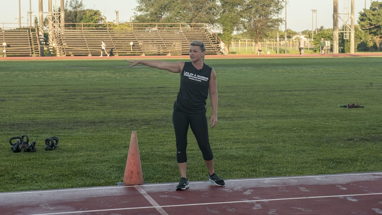 Missy Cornish, wife of Brig. Gen. Barry Cornish, 18th Wing Commander, leads a Warrior Training Fitness session June 28, 2017, at the Risner Fitness and Sports Complex on Kadena Air Base, Japan. Cornish lead and helped start the Warrior Training Fitness workout series. (U.S. Air Force photo/Airman 1st Class Greg Erwin)