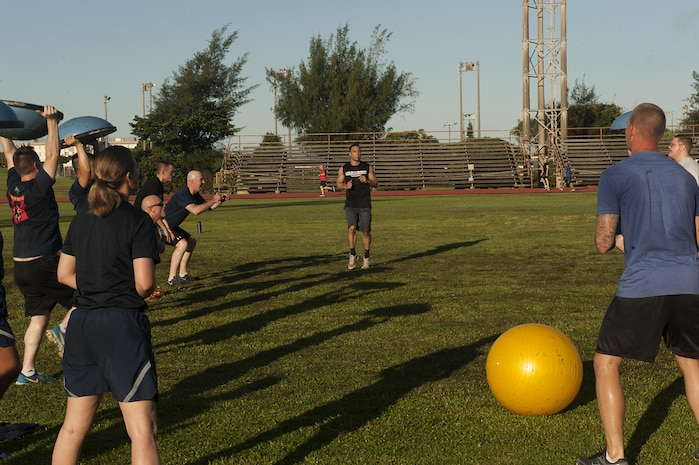 U.S. Air Force 1st Lt. Jonathon McKnight, 718th Civil Engineering Squadron OIC requirements & optimization officer leads a workout station at a Warrior Training Fitness workout June 28, 2017, at the Risner Fitness and Sports Complex, Kadena Air Base, Japan. McKnight and other leaders volunteered to help run the fitness program, and motivated attendees to push through the each high-intensity exercise station. (U.S. Air Force photo/Airman 1st Class Greg Erwin)