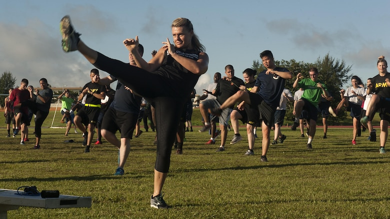 Missy Cornish, fitness professional, leads a Muay Thai exercise as a part of a Warrior Training Fitness workout June 28, 2017, at the Risner Fitness and Sports Complex, Kadena Air Base, Japan. Cornish developed the Warrior Training Fitness program as a way to reinforce physical resilience and promote alternative workout methods. (U.S. Air Force photo/Airman 1st Class Greg Erwin)