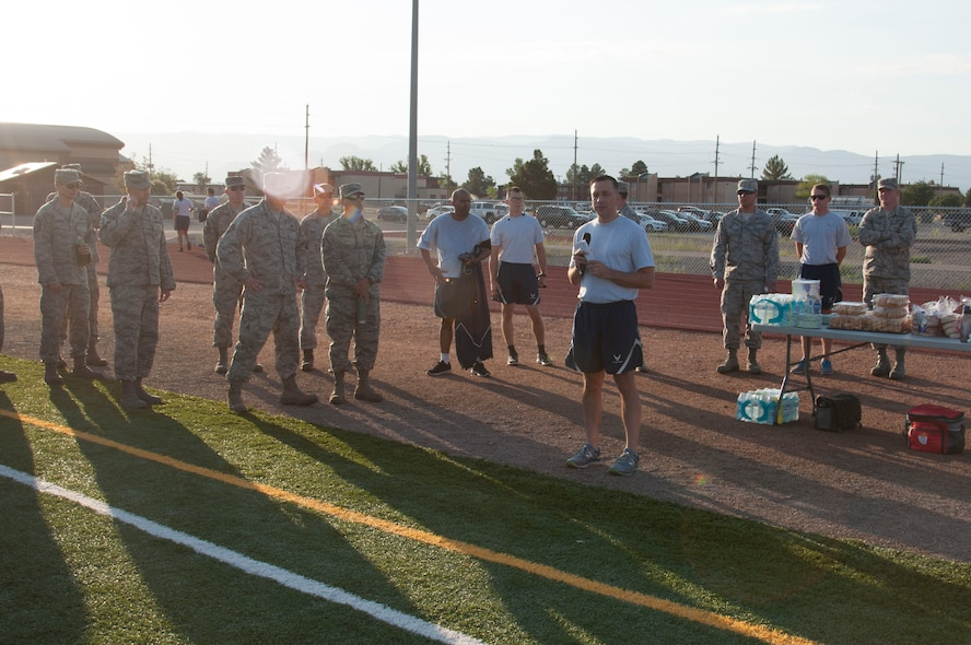 Col. Lyle Drew, 49th Maintenance Group commander, briefs 49 MXG Airmen before the 49th MXG 101 Days of Training 100 percent PT competition at Holloman Air Force Base, June 27, 2017. On March 6, 2017, the 49th MXG began invigorating the training culture by strengthen the maintainers' competence and focus on upgrade and proficiency training through events such as noncommissioned officer speed mentoring, 100 percent PT competition, 'How to be a Millionaire' brief, and a Consolidated Tool Kit (CTK)/Aircraft Forms and Documentation competition took place over the 15-week period. (Courtesy photo)