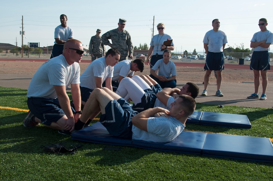 Airmen from the 49th Maintenance Group compete in the sit-up muscular component of the 49th MXG's 101 Days of Training 100 percent PT competition at Holloman Air Force Base, June 27, 2017. On March 6, 2017, the 49th MXG began invigorating the training culture by strengthen the maintainers' competence and focus on upgrade and proficiency training through events such as noncommissioned officer speed mentoring, 100 percent PT competition, 'How to be a Millionaire' brief, and a Consolidated Tool Kit (CTK)/Aircraft Forms and Documentation competition took place over the 15-week period. (Courtesy photo)
