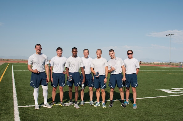 Col. Lyle Drew, (center) 49th Maintenance Group commander, poses with the competitors from the 49th MXG's 101 Days of Training 100 percent PT competition on Holloman Air Force Base, June 27, 2017. On March 6, 2017, the 49th MXG began invigorating the training culture by strengthen the maintainers' competence and focus on upgrade and proficiency training through events such as noncommissioned officer speed mentoring, 100 percent PT competition, 'How to be a Millionaire' brief, and a Consolidated Tool Kit (CTK)/Aircraft Forms and Documentation competition took place over the 15-week period. (Courtesy photo)