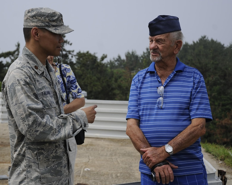 U.S. Air Force Maj. Jeric Talania, 8th Fighter Wing Protocol officer in charge, speaks with retired Buck Sgt. Richard Morse, Korean War veteran and former security forces patrolman, June 30, 2017, during a tour at Kunsan Air Base, Republic of Korea. Morse served at the former Kimpo Air Base, or K-14, in the Korean War, safeguarding F-86 Sabres during his enlistment. (U.S. Air Force photo by Staff Sgt. Victoria H. Taylor/Released)