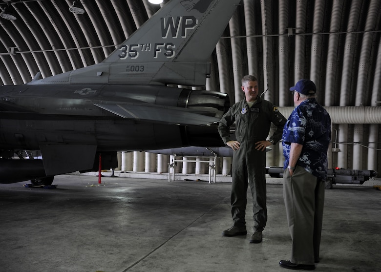 U.S. Air Force Col. David G. Shoemaker, 8th Fighter Wing commander, speaks with retired Lt. Col. Roy Compton, 3rd Bomb Wing veteran and former B-26 navigator, June 30, 2017, during a tour at Kunsan Air Base, Republic of Korea. Visitors were able to tour the F-16 Fighting Falcon and meet with Wolf Pack leadership during their short tour of the installation. (U.S. Air Force photo by Staff Sgt. Victoria H. Taylor/Released)