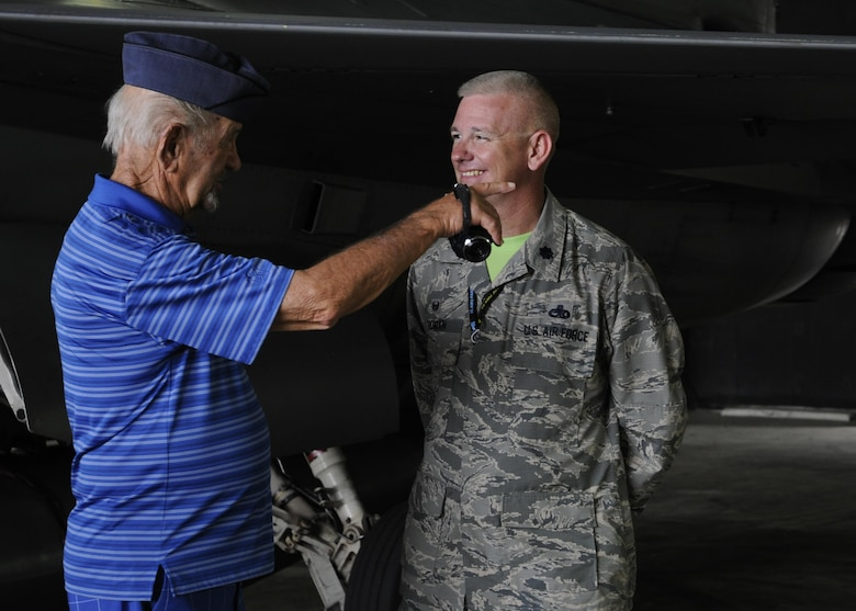 U.S. Air Force Lt. Col. Christopher Tooman, 8th Aircraft Maintenance Squadron commander, speaks with retired Buck Sgt. Richard Morse, Korean War veteran and former security forces patrolman, June 30, 2017, during a tour at Kunsan Air Base, Republic of Korea. Members of the Korean War Veterans Association, which is comprised of veterans and their families, visited the major landmarks on the installation while meeting Wolf Pack Airmen. (U.S. Air Force photo by Staff Sgt. Victoria H. Taylor/Released)