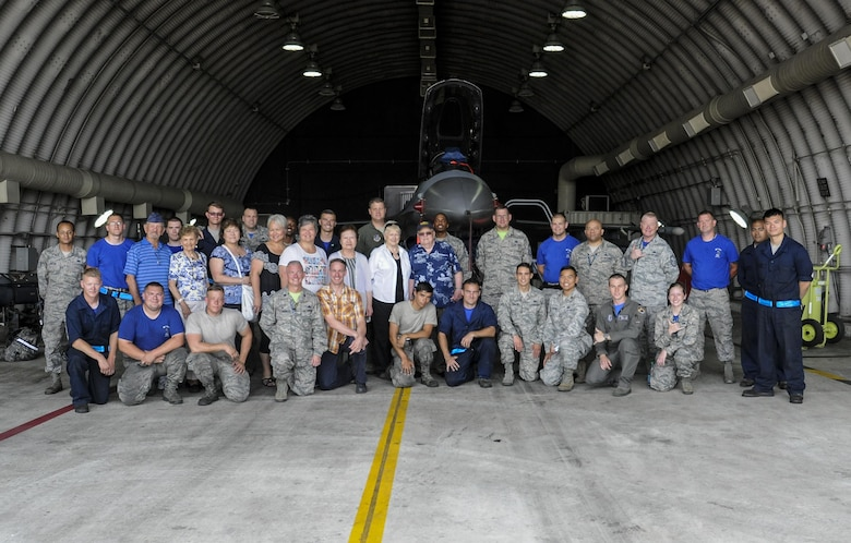 U.S. Air Force Airmen assigned to the 8th Aircraft Maintenance Squadron and Korean War veterans and their families pose for a photo June 30, 2017, during a tour at Kunsan Air Base, Republic of Korea. Members of the Korean War Veterans Association, which is comprised of veterans and their families, received the tour as a sign of thanks for the sacrifices they endured in order to make the Wolf Pack what it is today. (U.S. Air Force photo by Staff Sgt. Victoria H. Taylor/Released) (U.S. Air Force photo by Staff Sgt. Victoria H. Taylor/Released)