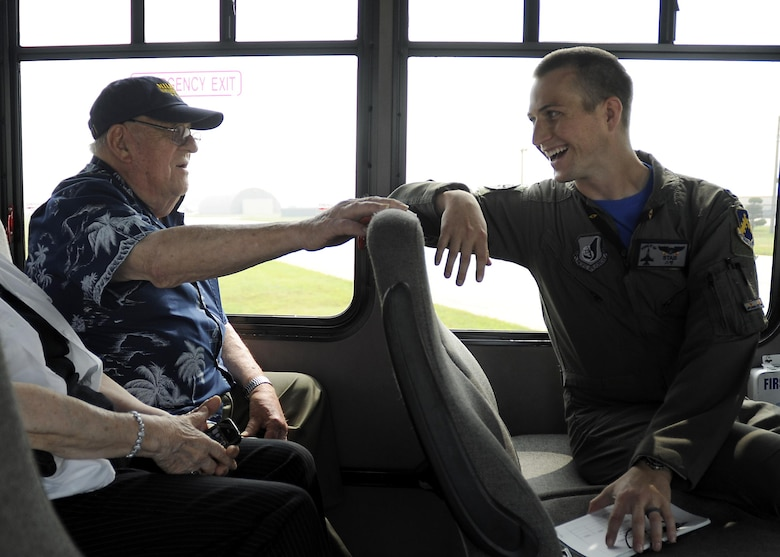 Retired U.S. Air Force Lt. Col. Roy Compton, 3rd Bomb Wing veteran and former B-26 navigator, speaks to Capt. Matt Schuetz, 35th Fighter Squadron B Flight  commander, June 30, 2017, during a tour at Kunsan Air Base, Republic of Korea. Compton served at Kunsan during the Korean War and flew more than 50 missions out of the air base from 1952 to 1953. (U.S. Air Force photo by Staff Sgt. Victoria H. Taylor/Released)
