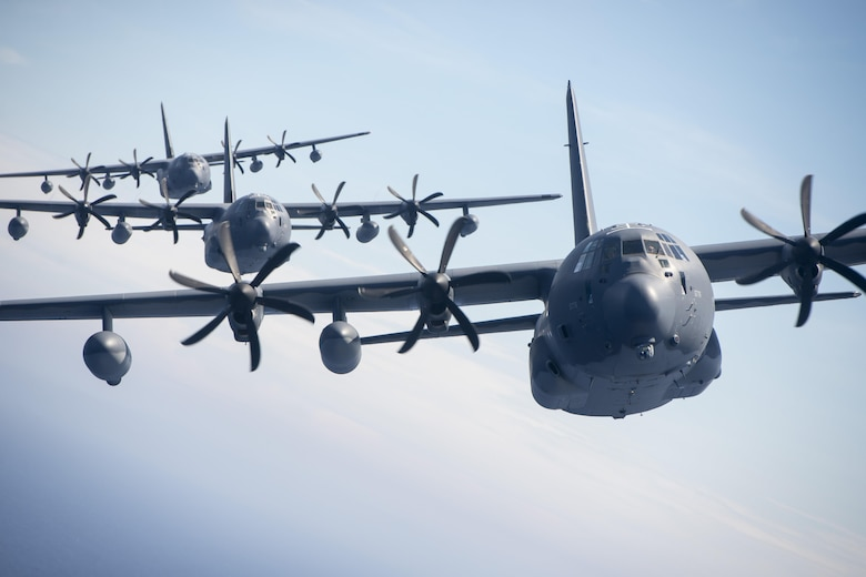 U.S. Air Force MC-130J Commando IIs from the 17th Special Operations Squadron line up in a five-aircraft formation during a mass launch training mission June 22, 2017 off the coast of Okinawa, Japan. Routine flights and airdrops are conducted to maintain proficiency and training certifications for prospective missions. (U.S. Air Force photo by Senior Airman John Linzmeier)