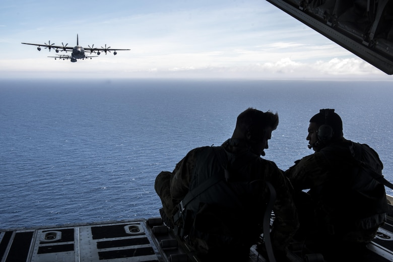 U.S. Air Force loadmaster Airmen, from the 17th Special Operations Squadron, overserve a five-aircraft formation comprised of MC-130J Commando IIs June 22, 2017 off the coast of Okinawa, Japan, during a mass launch training mission. Airmen from the 17th SOS conduct training operations often to ensure they are always ready perform a variety of high-priority, low-visibility missions throughout the Indo-Asia-Pacific-Region. (U.S. Air Force photo by Senior Airman John Linzmeier)