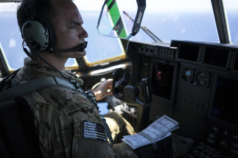 A U.S. Air Force MC-130J Commando II pilot assigned to the 17th Special Operations Squadron flies the Commando II during a mass launch training mission June 22, 2017, off the coast of Okinawa, Japan. Airmen from the 17th SOS conduct training operations often to ensure they are always ready perform a variety of high-priority, low-visibility missions throughout the Indo-Asia-Pacific-Region. (U.S. Air Force photo by Capt. Jessica Tait)