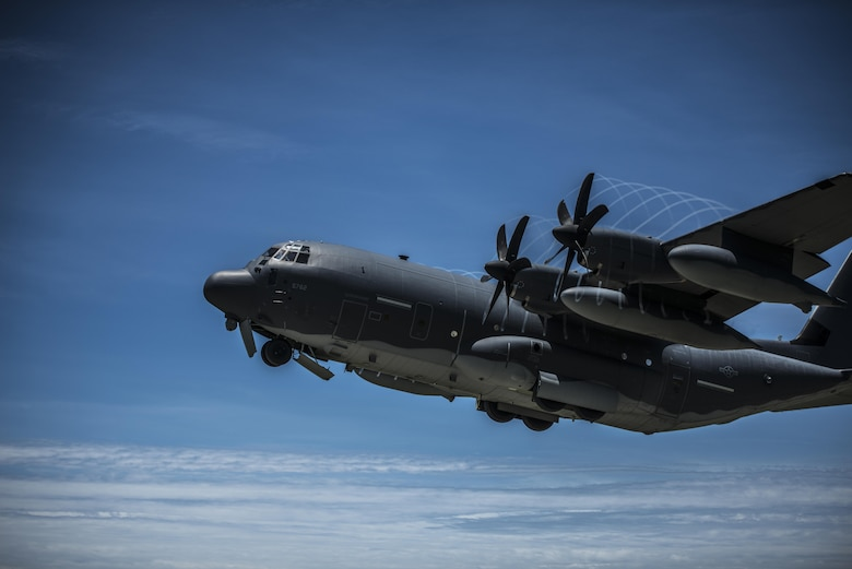 A U.S. Air Force MC-130J Commando II flies during a mass launch training mission June 22, 2017, at Ie Shima Range, Okinawa, Japan. Routine flights and airdrops are conducted to maintain proficiency and training certifications for prospective missions. (U.S. Air Force photo by Capt. Jessica Tait)